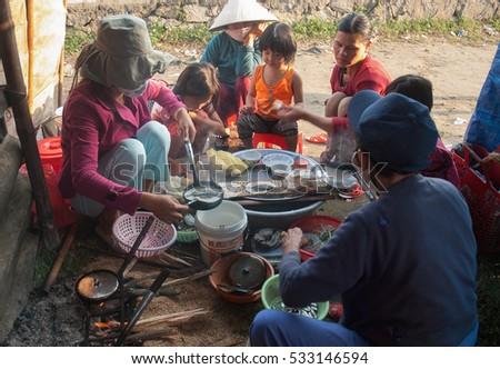 Hue, Vietnam, September 22, 2016 women and children, rural Hue, central Vietnam, preparing food in the morning, bread called XEO