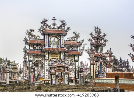 HUE, VITNAM - MARCH 3, 2016: Hundreds of giant tombs have been erected on the beach of An Bang Village, Vietnam, not far outside of Hue. The tombs are mostly buildt by vietnamese from overseas.