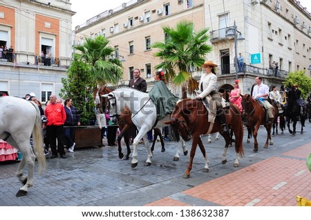 HUELVA, ANDALUCIA, SPAIN - MAY 15: The Brotherhood of Migrants in the way to of El Rocio in front of town hall in Huelva, is celebrated the pilgrimage, to El Rocio on May 15, 2013 in Huelva, Spain