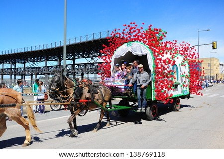 HUELVA, ANDALUCIA, SPAIN - MAY 16: The pilgrimage of El Rocio, the Brotherhood of Huelva, with mule drawn carriage in the way to of El Rocio on May 16, 2013 in Huelva, Spain