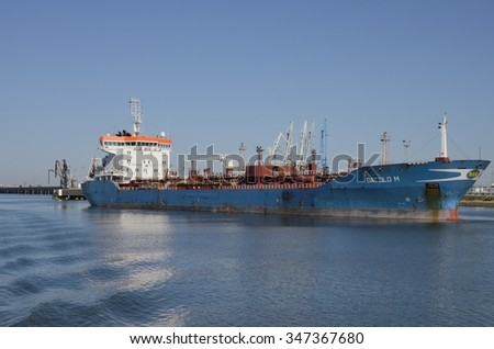 HUELVA, SPAIN - DECEMBER 3: Cargo ship on Odiel river at the Port of Huelva, Andalusia, Spain on December 3, 2015.