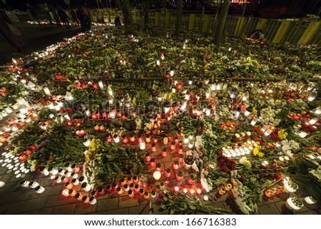 Huge amount of Flowers and Candles in front of place of a tragedy