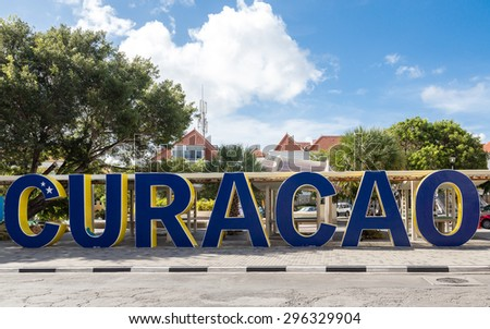 Huge blue sign spelling out Curacao in city park