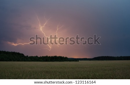 Huge bolt of lightnings and summer field. landscape