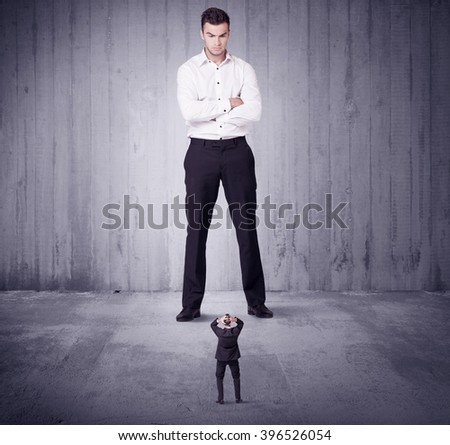 Huge boss manager lokking at small business man concept on background - stock photo