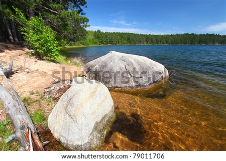 Huge boulder along the shoreline of Buffalo Lake in the Northern Highland-American Legion State Forest of Wisconsin - stock photo