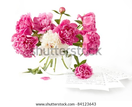 Huge bunch of pink and white peonies in vase isolated on white