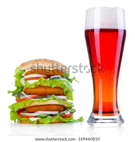 Huge burger and glass cold beer, isolated on white