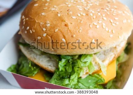 Huge burger ready to be eaten - stock photo