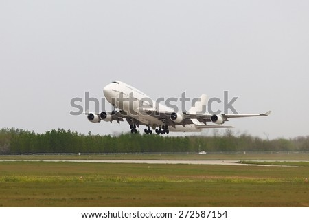 Huge cargo plane being towed - stock photo