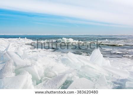 Huge chunks of fresh water ice on Lake Eire in Northwest Ohio. Beautiful winter scene. - stock photo