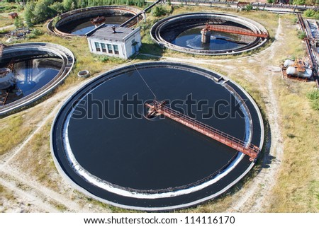 Huge circular sedimentation tank  Water settling, purification in the tank by biological organisms on the water station - stock photo
