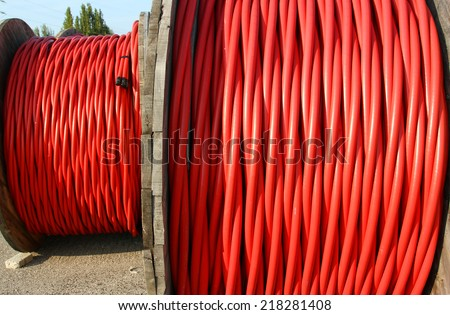 huge coil of high voltage power cable the power the electric utilities - stock photo