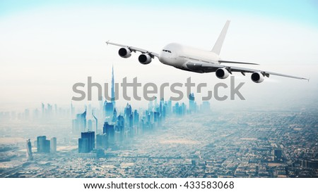 Huge commercial airplane flying over Dubai city