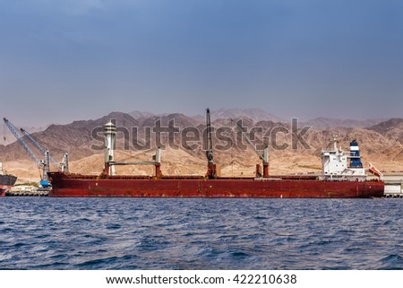 Huge container cargo at the shore - stock photo