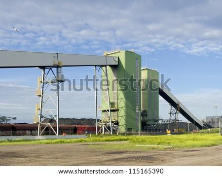 huge conveyor belt for the coal industry in Rotterdam harbor - stock photo