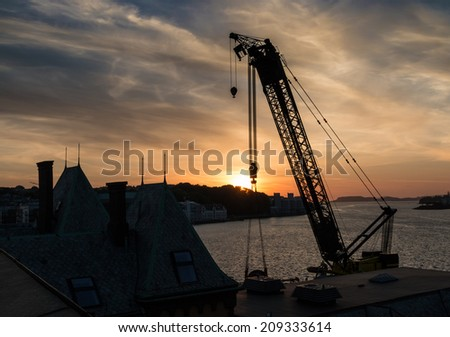 Huge crane silhouette in the sunset over the port of Stavanger, Norway