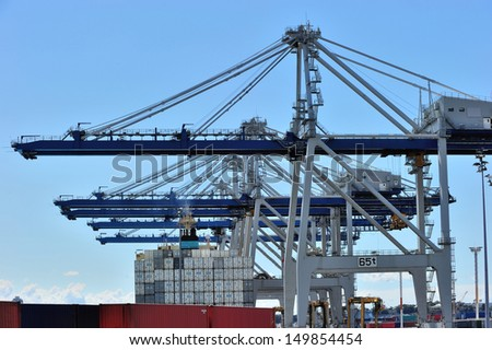 Huge cranes at the port of Auckland, New Zealand - stock photo
