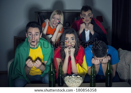 Huge emotion during the watching soccer on TV  - stock photo