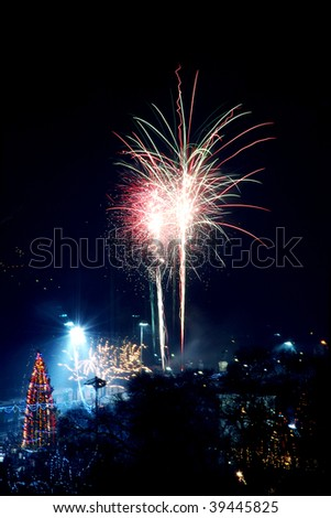 Huge fireworks and big christmas tree in a public square. Great file for your publications about New 2014 Year celebrations.