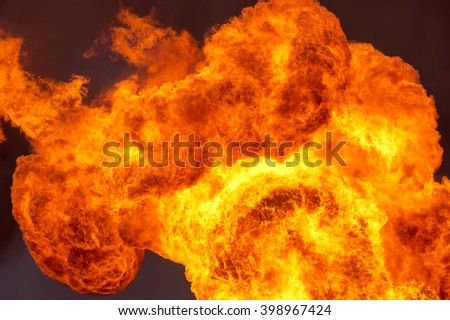 Huge flame against the black sky - stock photo