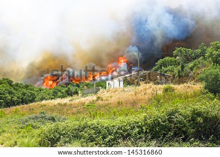 Huge forest fire threatens homes in Portugal - stock photo