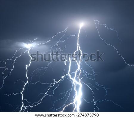 Huge fork lightnings and thunder during heavy summer storm. - stock photo