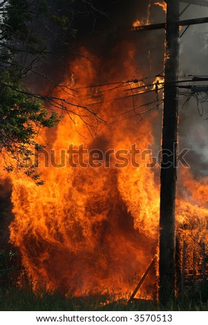 Huge garage fire catches an electrical pole on fire