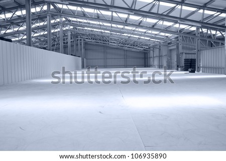Huge gray and light warehouse with metal roof - stock photo