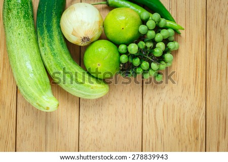 Huge group of fresh vegetables and fruit on wooden background