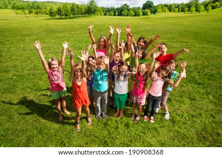 Huge group of kids in the park - stock photo