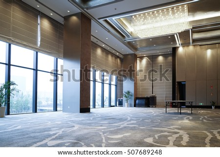 Huge Hall interior with carpet and ceiling with lights as conference hall in luxury hotel.