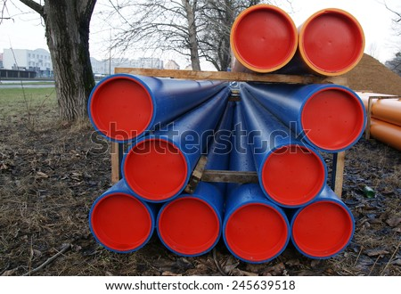 Huge heating plastic/pvc pipes used in building construction - stock photo
