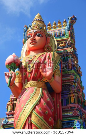 Huge Hindu Goddess  statue in front of temple - stock photo