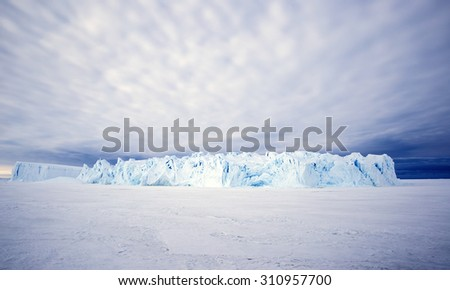 Huge Iceberg in the Antarctic - stock photo