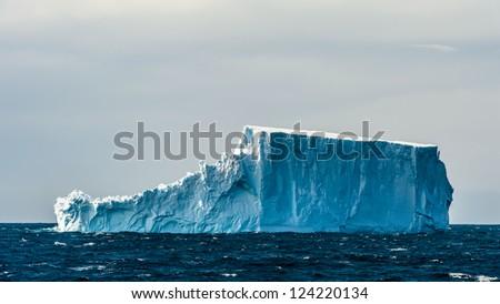 Huge iceberg of South Georgia, British overseas territory, Southern Atlantic Ocean. - stock photo
