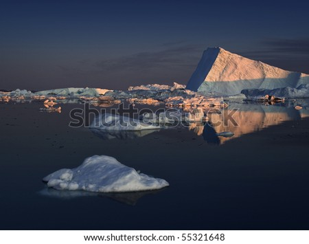 Huge icebergs of Greenland in the light of a decline - stock photo