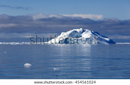 Huge icebergs of Greenland.Travel on the scientific vessel among ices. Studying of a phenomenon of global warming. Importance of preservation of ecological balance. Deep-water fjords with clear water. - stock photo