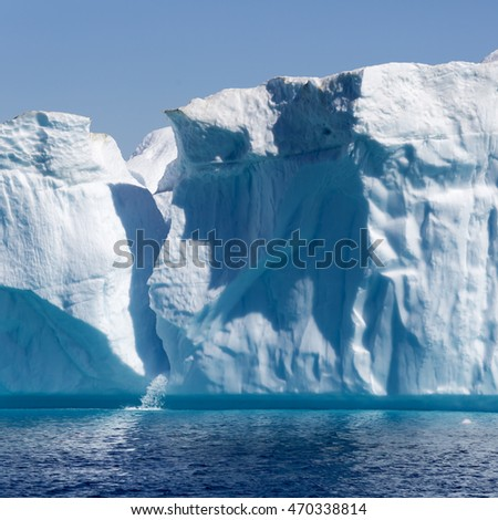 Huge icebergs.Travel on the scientific vessel among ices. Studying of a phenomenon of global warming. Importance of preservation of ecological balance. Deep-water fjords with clear water