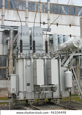 Huge industrial high voltage converter at a power plant - stock photo