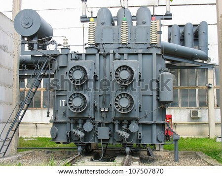 Huge industrial high-voltage substation power transformer at an power plant
