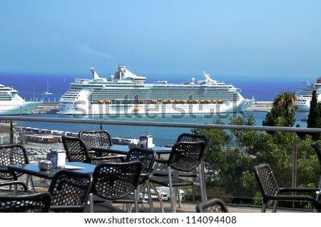 Huge luxury cruise ship in a harbor - stock photo