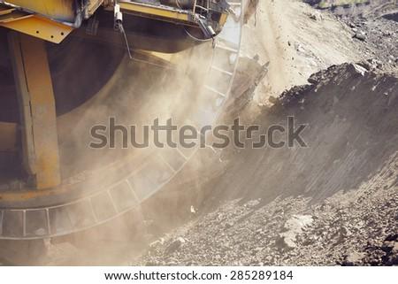 Huge mining machine in the coal mine - stock photo