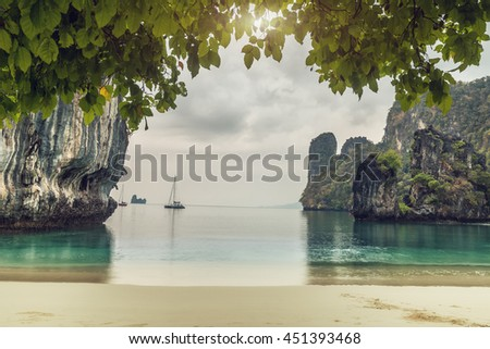 Huge mountains with branches of tree on island of Koh Hong, Krabi province, Thailand - stock photo