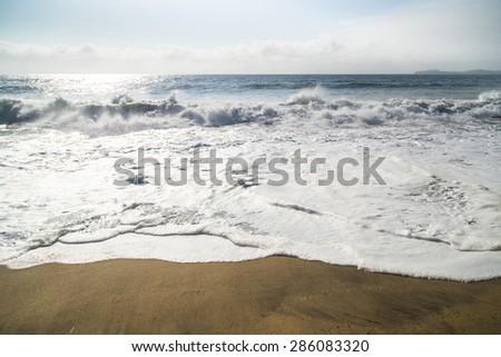 Huge Ocean Waves in Half Moon Bay in Big Sur, California - stock photo