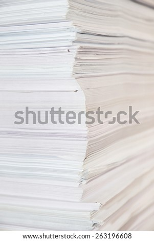 Huge paper stack close-up, view from the corner - stock photo