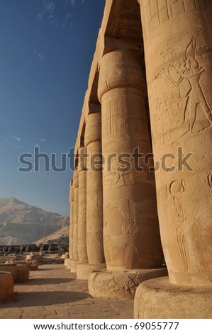 Huge papyrus columns of the hypostyle hall in the Ramesseum, the ancient egyptian mortuary temple of Ramses II at thebes near Luxor, Egypt - stock photo