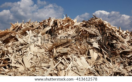 Huge pile of wood waste for recycling - stock photo
