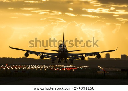 Huge plane is landing on the runway. - stock photo
