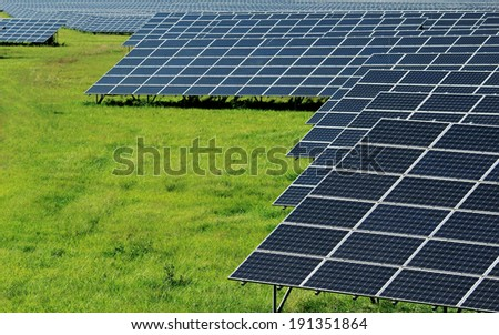 huge power solar plant on the green field - stock photo